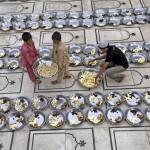 volunteers-prepare-plates-food-mosque-iftar-evening-meal