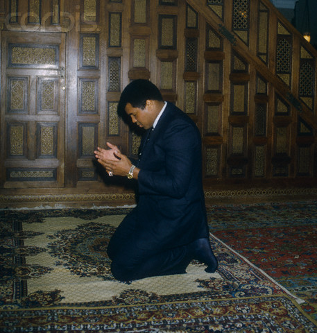 24 Apr 1982, Cannes, France --- Muhammad Ali Praying --- Image by © Richard Melloul/Sygma/CORBIS